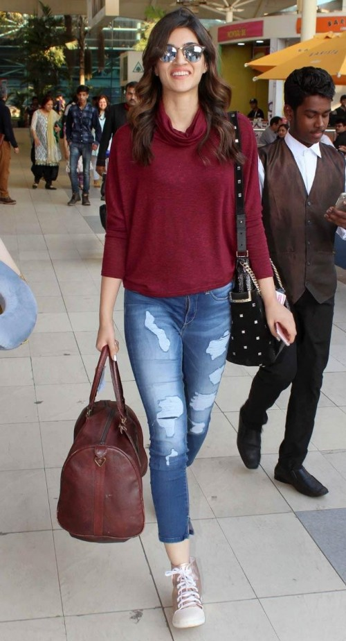 Want Kriti Sanon's outfit , the maroon turtle neck top and ripped denims please - SeenIt