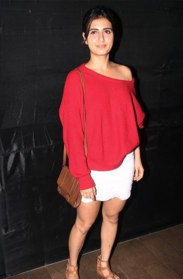Yay or Nay? Fatima Sana Sheikh wearing a red drop shoulder sweatshirt with a white skirt at the screening of Secret Superstar - SeenIt