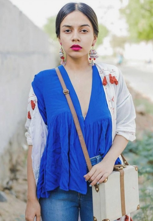help me find a similar blue top and the exact white box bag which komal is wearing! - SeenIt