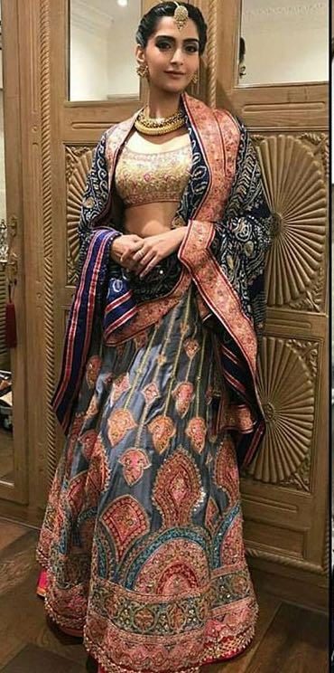 Yay or Nay? Sonam Kapoor wearing a blue and golden embroidered Abu Jani & Sandeep Khosla lehenga attire on Diwali last night - SeenIt