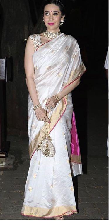 Yay or Nay? Karisma Kapoor wearing a white silk saree with golden border on diwali last night - SeenIt