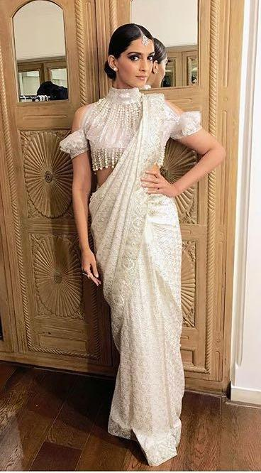 Yay or Nay? Sonam Kapoor wearing an ivory embroidered cold shoulder tassel saree by Abu Jani & Sandeep Khosla at Ekta Ravi Kapoor's diwali party - SeenIt