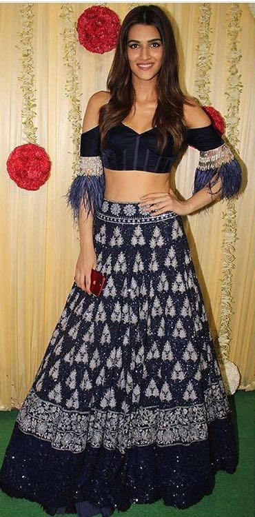 Yay or Nay? Kriti Sanon wearing a cold shoulder blue lehenga and crop top outfit by Manish mahotra at Ekta Ravi Kapoor's diwali party - SeenIt