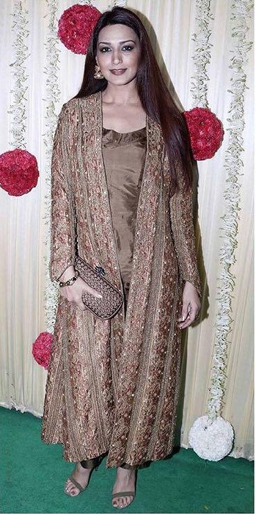 Yay or Nay? Sonali Bendre wearing a golden brown embroidered cape jacket suit at Ekta Ravi Kapoor's diwai party - SeenIt