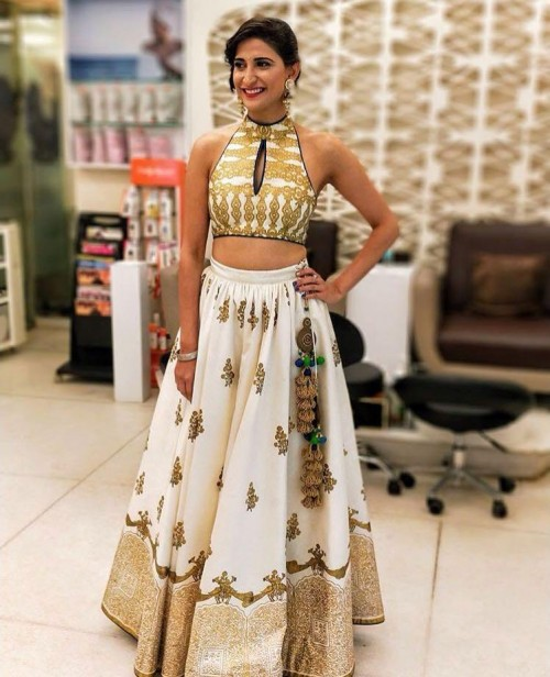 Yay or Nay? Aahana Kumra wearing a white and golden crop top and skirt attire at diwali party - SeenIt