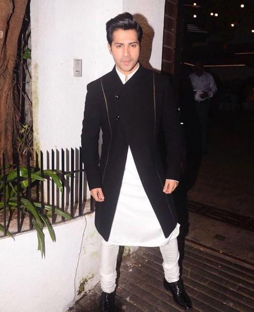 Yay or Nay? Varun Dhawan wearing a black front open Manish Malhotra jacket with kyrta pyjama at a diwali party - SeenIt
