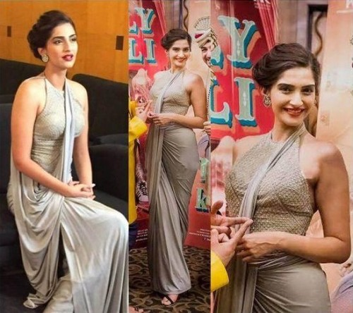 Want a similar grey draped saree like the one which Sonam Kapoor is wearing - SeenIt