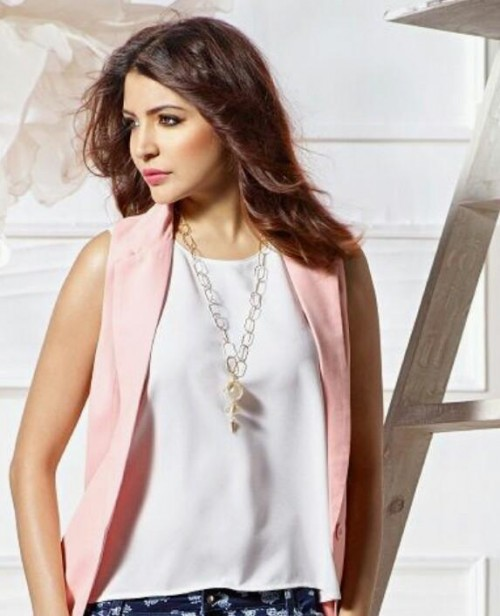 want this whole outfit which Anushka Sharma is wearing , the white top and pink shrug - SeenIt