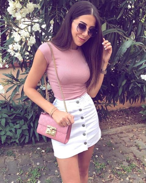 I am looking for the exact same outfit , the white front buttoned skirt with a pink bodycon crop top - SeenIt