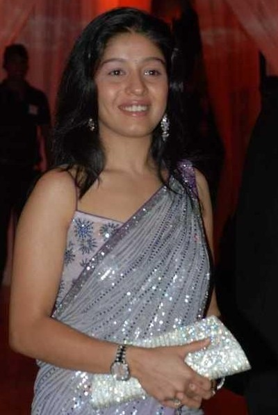 Sunidhi Chauhan shiny silver dress and clutch - SeenIt