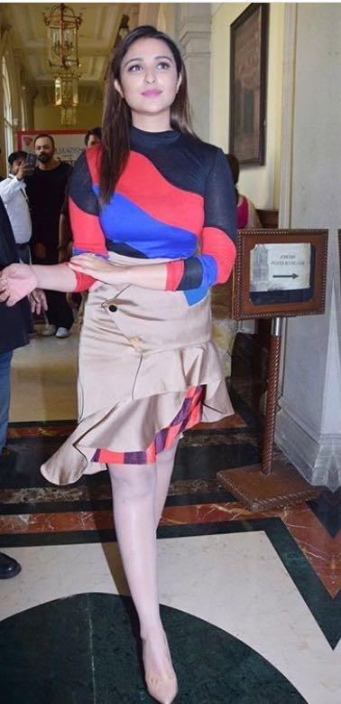 Yay or Nay? Parineeti Chopra wearing a color block blue and red top with a golden peplum skirt at Golmaal again Interviews - SeenIt