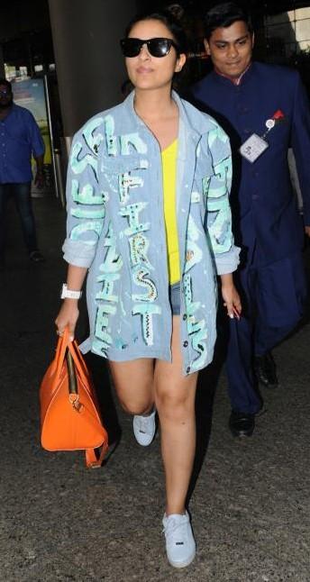 Yay or Nay? Parineeti Chopra wearing a denim jacket with white sneakers at Mumbai airport - SeenIt
