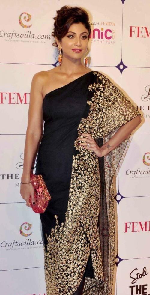 shilpa shetty off shoulder black and gold embroidered half draped kaftan Saree by nikhil thampi at femina craftsvilla event - SeenIt