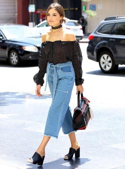 Olivia Culpo black off shoulder top and blue denim culottes - SeenIt