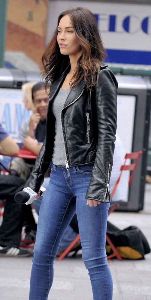 Megan Fox Grey Top, Black Biker Jacket and Blue Skinny Jeans - SeenIt