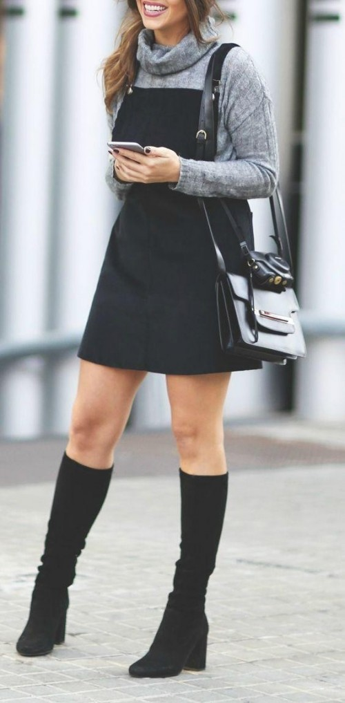 This grey cowl neck sweater with black dungaree dress and knee-high boots - SeenIt