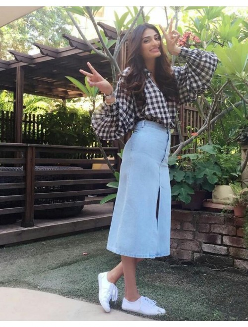 Athiya Shetty black checked top blue denim midi skirt and white sneakers outfit - SeenIt