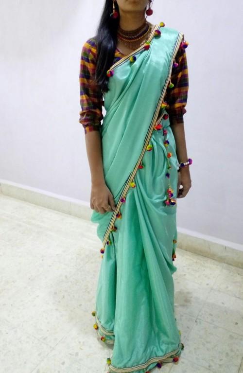 How do you like this outfit of plain aqua saree with pompoms?? - SeenIt