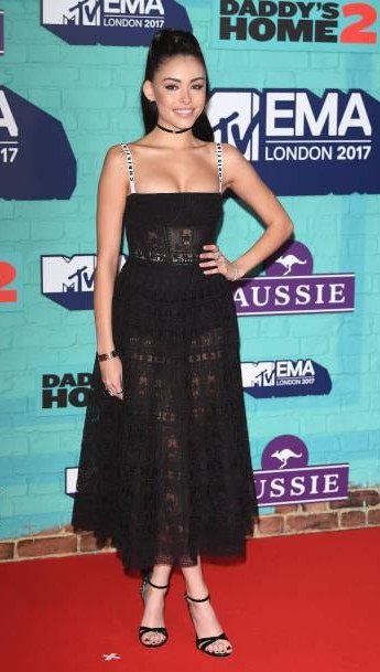 Yay or Nay?  Madison Beer attends the MTV EMAs 2017 held at The SSE Arena wearing a black strapless midi lace dress - SeenIt