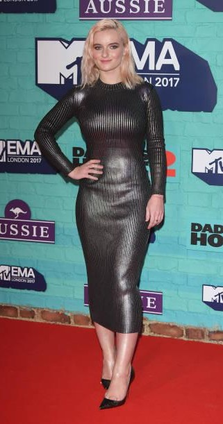 Yay or Nay?  Grace Chatto of Clean Bandit attends the MTV EMAs 2017 held at The SSE Arena wearing a black bodycon midi dress - SeenIt