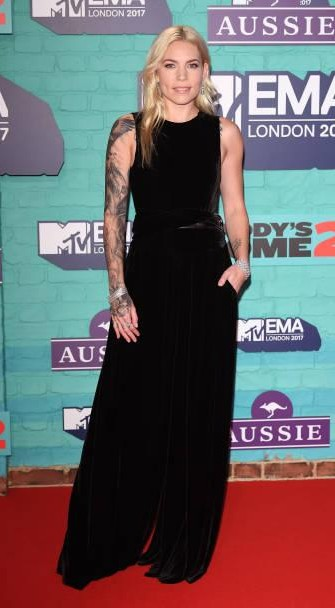 Yay or Nay?  Skylar Grey attends the MTV EMAs 2017 held at The SSE Arena wearing a black velvet sleeveless gown - SeenIt