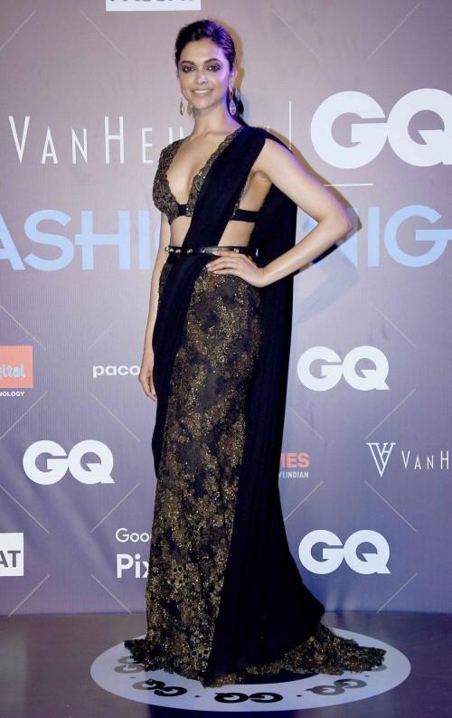 Yay or Nay? Deepika Padukone attends the GQ fashion nights this year wearing a black sari ensemble by Sabyasachi - SeenIt