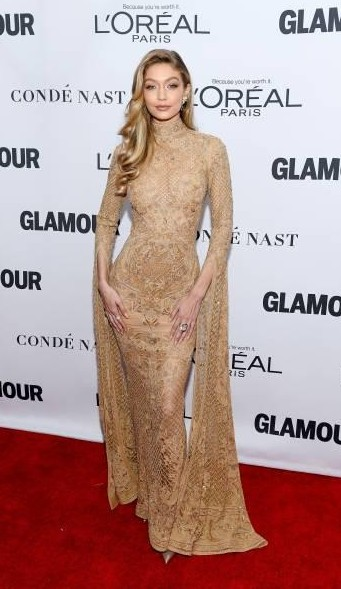 Yay or Nay?  Gigi Hadid attends the 2017 Glamour Women of the Year Awards wearing a beige golden gown with cape sleeves - SeenIt