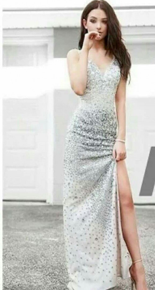 Please help me find and exact dress with silver embellishments and a slit. - SeenIt