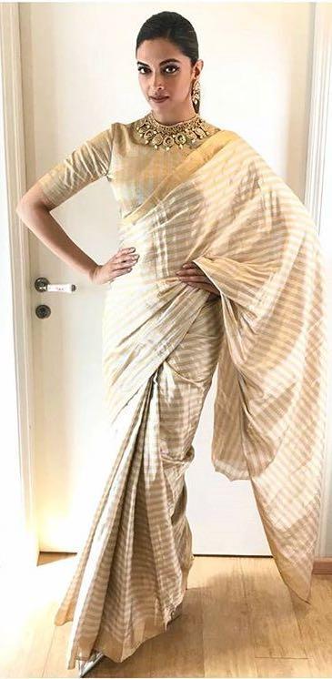 Deepika Padukone's gold saree from the promotions of Padmavati movie - SeenIt