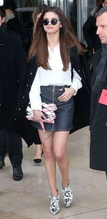 Selena Gomez white shirt, black blazer, sunglasses, colourful sling bag, animal print sneakers and denim miniskirt - SeenIt
