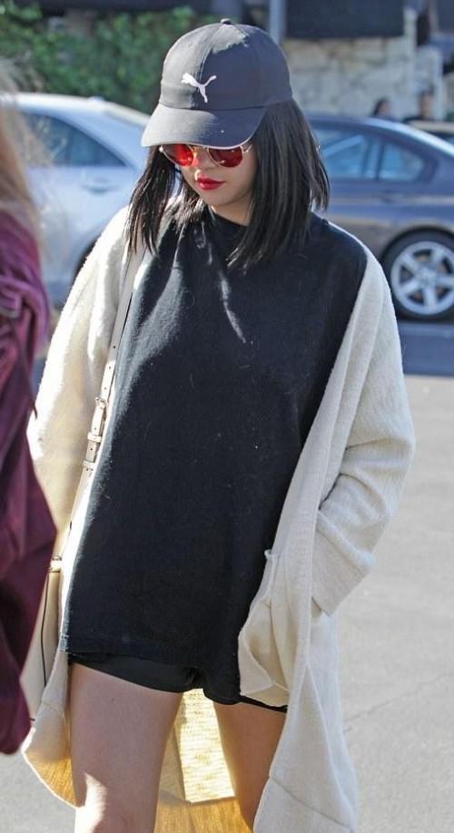 Selena Gomez's black tshirt dress , white shrug, blue cap and sunglasses - SeenIt
