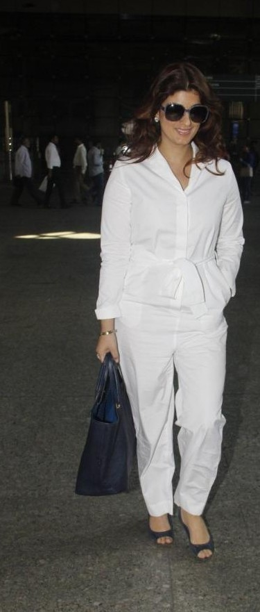 This white shirt and trousers with navy blue tote bag that Twinkle Khanna is flaunting - SeenIt
