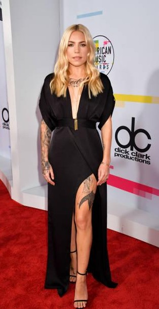 Yay or Nay?  Skylar Grey attends the 2017 American Music Awards wearing a black satin plunge neck slitted gown - SeenIt
