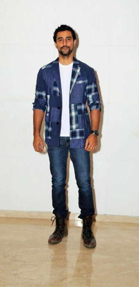 Yay or Nay? Kunal Kapoor wearing a printed shirt and blue denims at the Ed Sheeran party hosted by Farah Khan - SeenIt