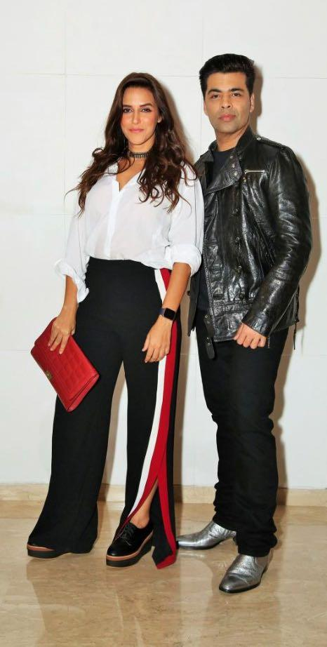 Yay or Nay? Karan Johar and Neha Dhupia spotted wearing black side striped pants and white shirt at the Ed Sheeran Party hosted by Farah Khan - SeenIt