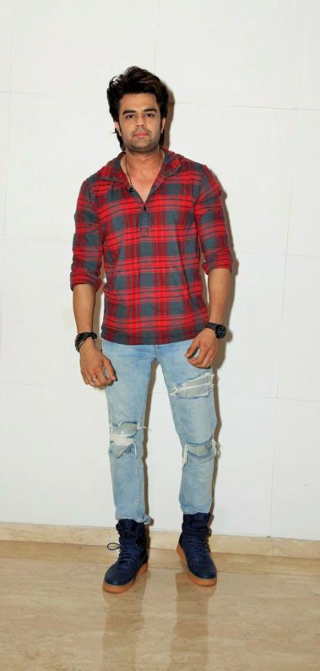 Yay or Nay? Manish Paul wearing a red checkered shirt and light blue ripped denims at Ed Sheeran party hosted by Farah Khan - SeenIt