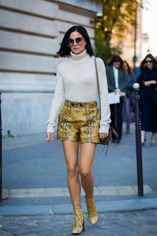 White turtleneck sweater and the snake print shorts and boots - SeenIt