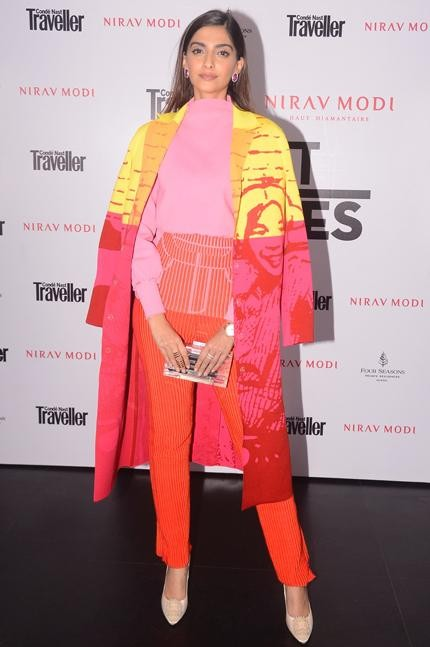 Yay or Nay? Sonam Kapoor in this pink top, orange pants and yellow-red jacket - SeenIt