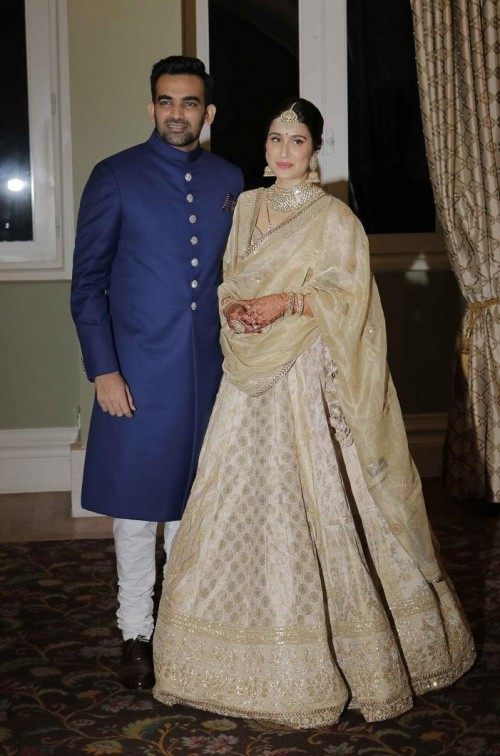 2882e962acf Yay or Nay  Zaheer Khan and Sagrika Ghatge spotted on their own wedding  reception wearing