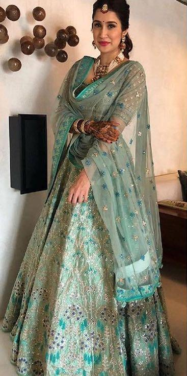 251c118255e Yay or Nay  Sagarika Ghatge spotted wearing a green Anita Dongre lehenga at  her own