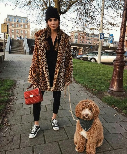 Animal print coat, black top , leggings, red quilted bag , black beanie ,black sneakers  and the dog 😂jk jk - SeenIt