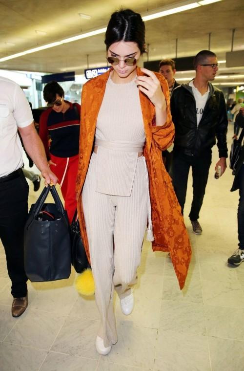Kendall Jenner orange print jacket at the Nice airport - SeenIt