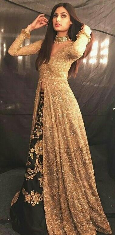Athiya Sherry outfit , the golden embroidered cape and lehenga skirt - SeenIt