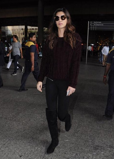 Kriti Sanon in a burgundy sweater and black leggings at the airport - SeenIt