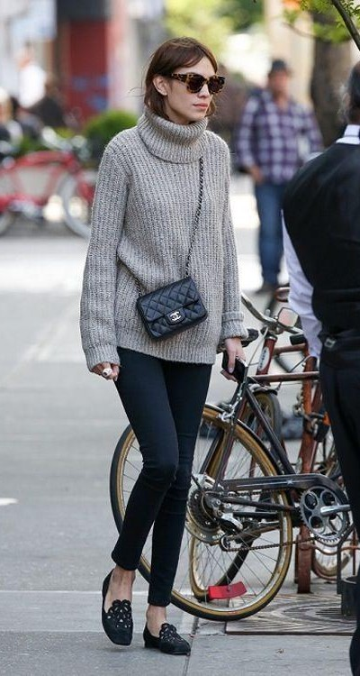 This grey sweater and black jeans that Alexa Chung is wearing - SeenIt