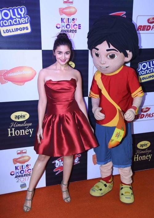 9cec2f435a Alia Bhatt wearing a red satin strapless skater dress by Gauri