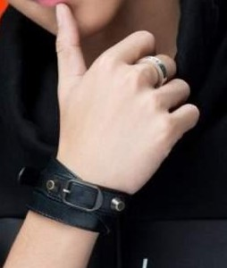 Looking for the black wristband and metal ring - SeenIt