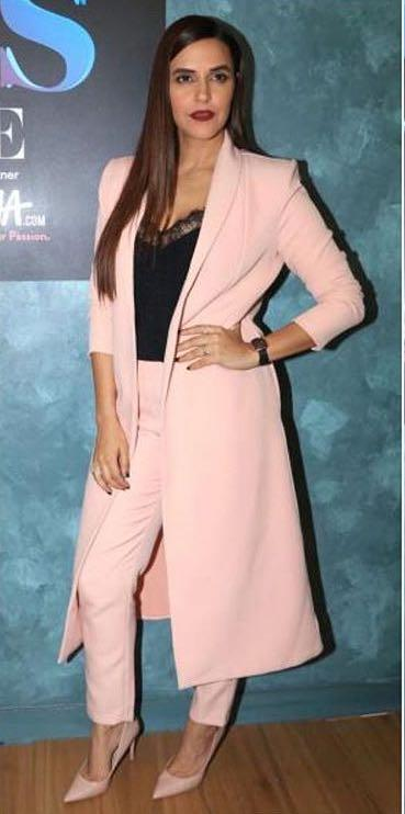 Neha Dhupia's pastel pink trousers and black camisole from the Vogue bff season 2 - SeenIt