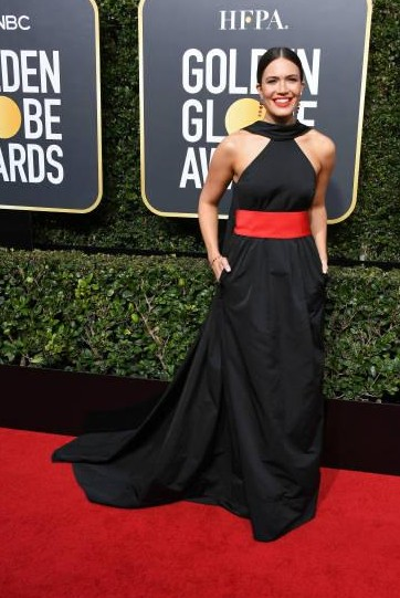 Yay or Nay? Mandy Moore attends The 75th Annual Golden Globe Awards at The Beverly Hilton Hotel wearing a black halter gown with red waist belt - SeenIt