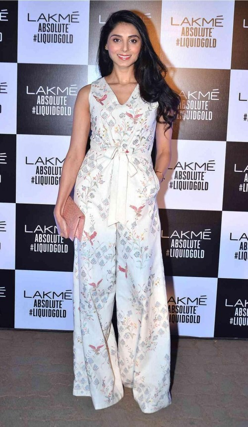 This ivory floral jumpsuit that Pernia Qureshi is wearing - SeenIt